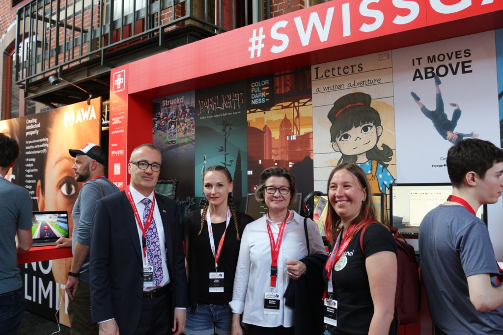 Ambassador of Switzerland to Sweden Christian Schoenenberger and his wife, together with Colourful Darkness and 5am Games studios (c) SWISSGAMES